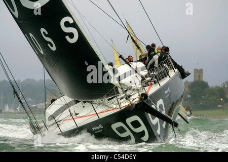Alex Thomson, Lewis Hamilton, Hugo Boss, J P Morgan, Round The Island Race, Start, Cowes, isle of Wight, England, - Stock Photo