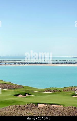 Yas Links Golf Course on Yas Island, skyline of Abu Dhabi at the back, Abu Dhabi, United Arab Emirates, Middle East, - Stock Photo