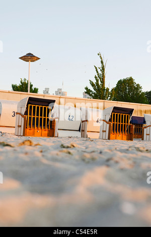 Roofed wicker beach chairs, beach, Baltic Sea, sunset, seaside resort of Ostseeheilbad Heiligendamm, Germany - Stock Photo
