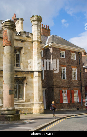 Roman Column and Minster School next to York Minster's South Entrance, York, Yorkshire, England, UK - Stock Photo