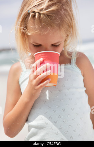 Girl drinking from disposable glass