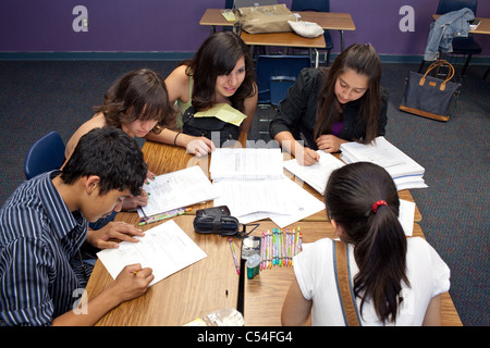 Male and female students work together in a small group on a class project at Mission Early College High School - Stock Photo