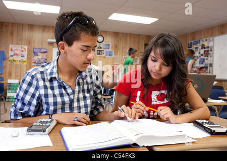 Male and female Hispanic students work together on assignment in math class at Mission Early College High School - Stock Photo