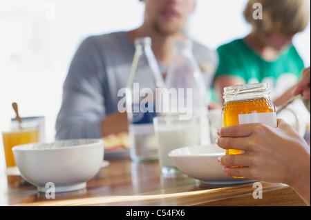 Family having breakfast at a dining table - Stock Photo