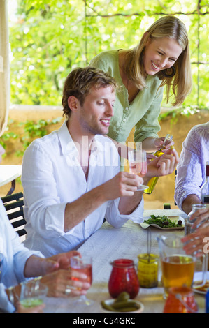 Happy family having drink at home - Stock Photo