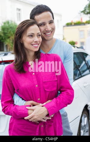 Man embracing a woman from behind - Stock Photo