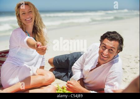 Mid adult couple on the beach - Stock Photo