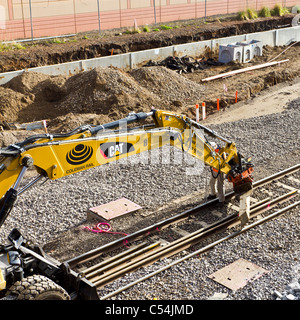Mechanical Rail Track Laying during railway upgrade - Stock Photo