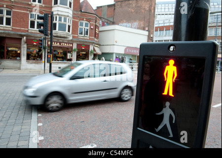 Red man symbol at a pedestrian crossing indicating it is not safe to cross the road. - Stock Photo