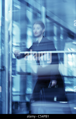 Businesswoman leaving from an office - Stock Photo