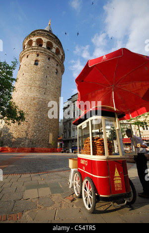 ISTANBUL, TURKEY. A cart selling simits (soft, sesame-coated bread rings) by the Galata Tower in Beyoglu district. - Stock Photo