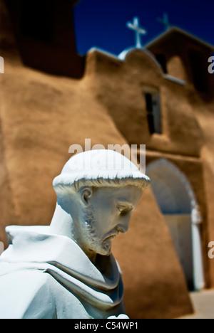 Statue in front of a church, Church Of San Francisco De Asis, Ranchos De Taos, New Mexico, USA - Stock Photo