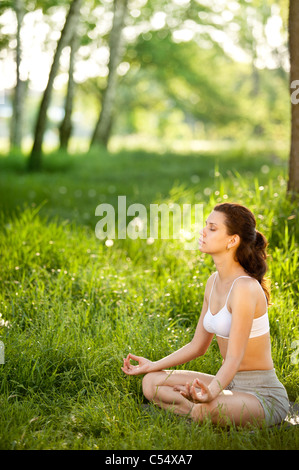 Practicing of yoga outdoors. - Stock Photo