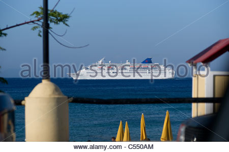 Cruise ship off the coast of Rhodes Island Greece - Stock Photo
