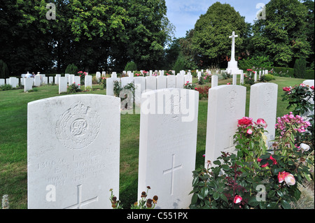 WWI Ramparts Cemetery / Lille Gate with Cross of Sacrifice and graves of British First World War One soldiers, Ypres, - Stock Photo