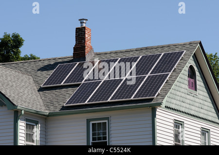 Photovoltaic solar panels on roof of  house - Stock Photo