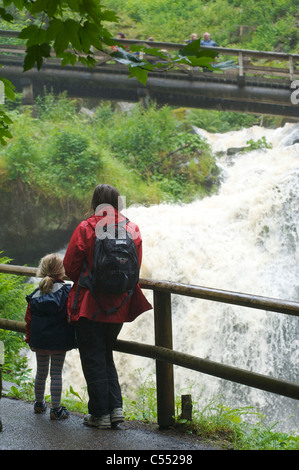People visiting the highest waterfall in Germany in Triberg, Black Forest, Baden-Wurttemberg - Stock Photo