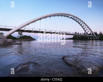 The Humber River Arch Bridge in Toronto during sunset also known as the Humber Bay Arch Bridge or the Gateway Bridge. - Stock Photo