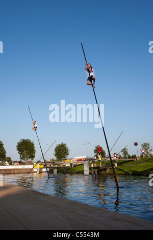 The Netherlands, IJlst, Competition of fenpoling, locally called Fierljeppen, crossing the water as far as you can. Stock Photo