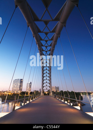 The Humber River Arch Bridge in Toronto during sunset also known as the Humber Bay Arch Bridge or the Gateway Bridge. - Stock Photo