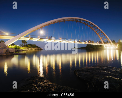 The Humber River Arch Bridge in Toronto at night also known as the Humber Bay Arch Bridge or the Gateway Bridge. - Stock Photo