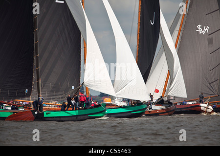The Netherlands, Elahuizen, Sailing races called Skutsjesilen, with traditional flat bottomed cargo boats called - Stock Photo