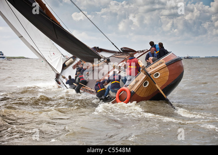 The Netherlands, Lemmer, Sailing races called Skutsjesilen, with traditional flat-bottomed cargo boats called Skutsjes. - Stock Photo