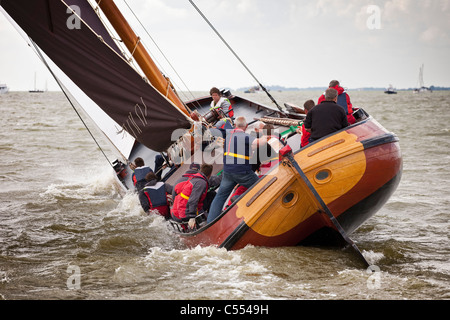 The Netherlands, Lemmer, Sailing races called Skutsjesilen, with traditional flat bottomed cargo boats called Skutsjes. - Stock Photo