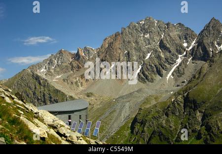 The Cabane du Velan of the Swiss Alpin Club (CAS) hidden in the Valsorey valley of the Pennine Alps, Valais, Switzerland - Stock Photo