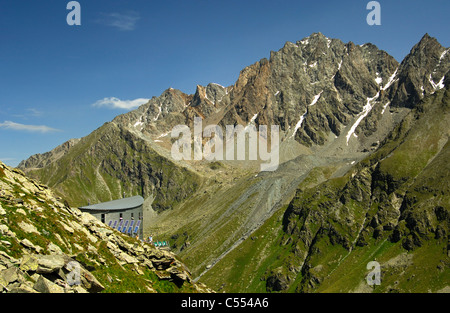 The Cabane du Velan of the Swiss Alpin Club (CAS) hidden in the Valsorey valley of the Pennine Alps, Valais, Switzerland - Stock Photo
