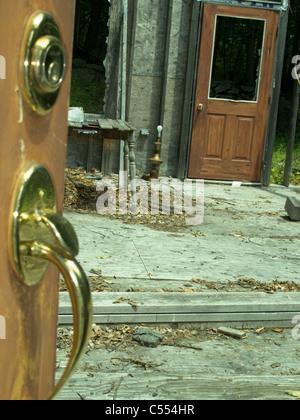 fire damaged house structure, abandoned, broken, door handle - Stock Photo