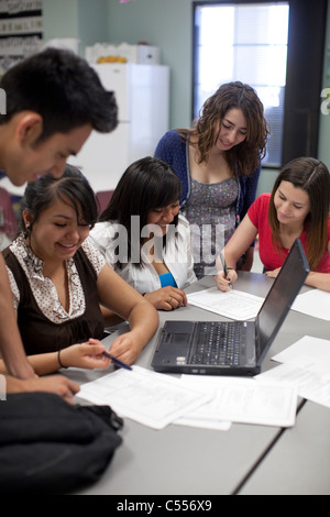 Male and female students use a laptop computer to collaborate on a class project at Mission Early College High School - Stock Photo