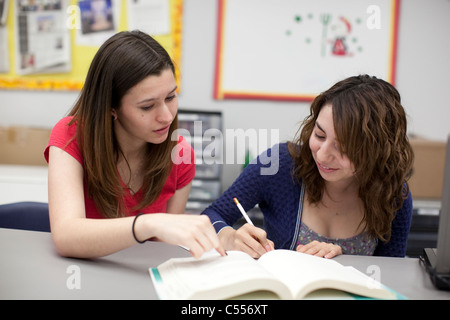 Female students collaborate on a class assignment at Mission Early College High School in El Paso, Texas - Stock Photo