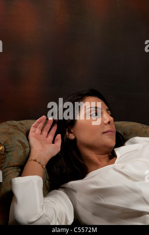 Woman lying on sofa - Stock Photo