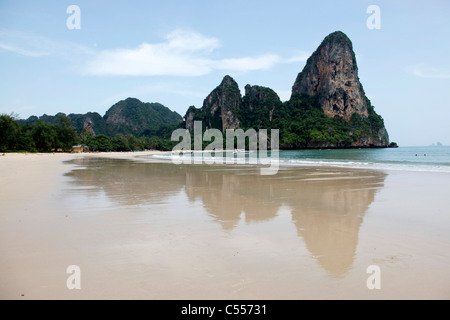 Beach scene showing sandy Railay Beach and reflection in the water of the island, Krabi, Thailand - Stock Photo