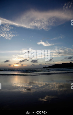 Sunset over the sea on Patong Beach in Patong, Phuket, Thailand - Stock Photo