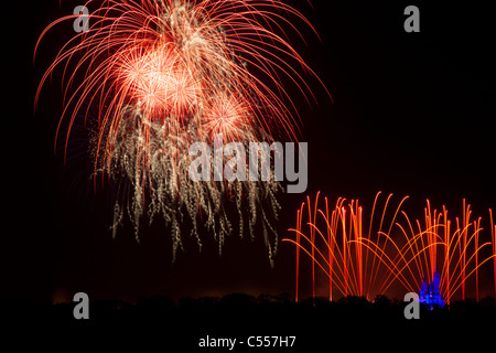 Walt Disney World Magic Kingdom Fireworks high in sky panoramic view from Grand Floridian Resort blue light on small - Stock Photo