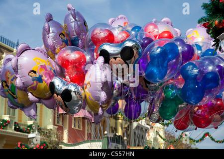 Large batch floating Character souvenir Helium Balloons on strings main street Walt Disney World Theme Park Florida - Stock Photo