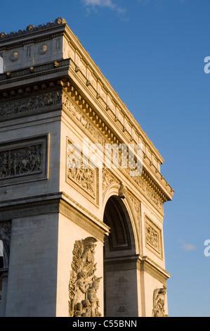 Low angle view of a triumphal arch, Arc De Triomphe, Paris, Ile-de-France, France - Stock Photo