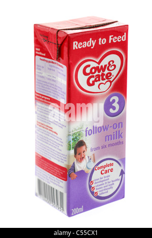 200 ml carton of Cow & Gate baby milk ready to feed 3 follow on milk from six months - Stock Photo