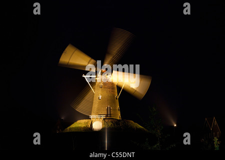 The Netherlands, Bredevoort, Windmill at night moving in floodlight. - Stock Photo