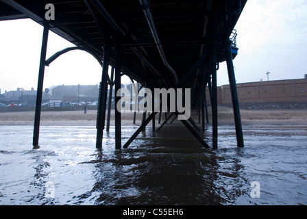 Steel Girders, Legs and Structural Supports Underneath The Pier, Cleethorpes, South Humberside, UK - Stock Photo