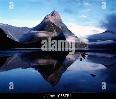 New Zealand, Fiordland National Park, Mitre Peak reflected in Milford Sound - Stock Photo