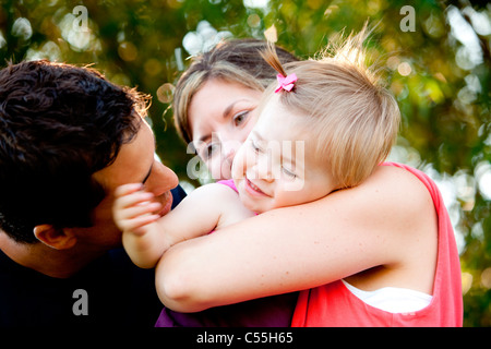 Parents with their daughter in a park, Traverse City, Grand Traverse County, Michigan, USA - Stock Photo