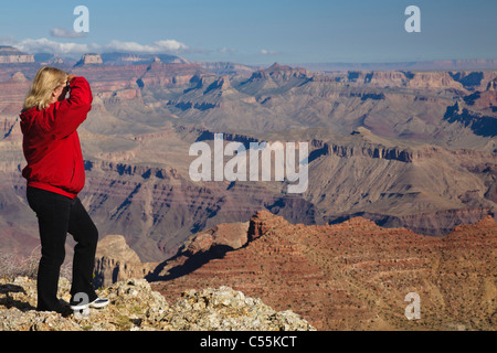 Tourist woman looking out over Navajo Point, Grand Canyon National Park, Arizona - Stock Photo