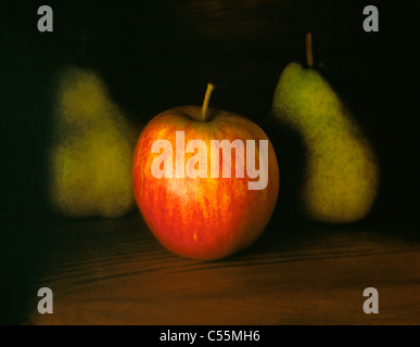 RED APPLE WITH TWO PEARS - Stock Photo