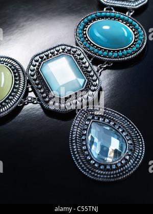 Pendant necklace jewellery isolated on black background - Stock Photo