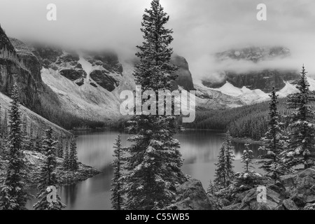 Calm lake by snow covered trees against sky stock photo for Columbia carpets enfield
