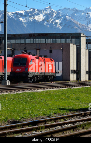 Two Austrian OeBB locomotives at the Swiss train station of Buchs SG, Switzerland CH - Stock Photo