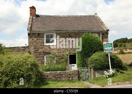 A cottage for sale and advertised as having holiday home potential in Derbyshire, England, U.K. - Stock Photo